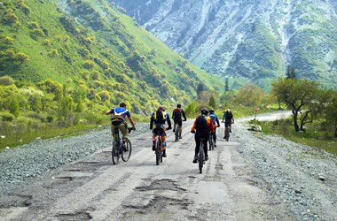 Biking on a mountain road. Travel insurance cover for your adventures.